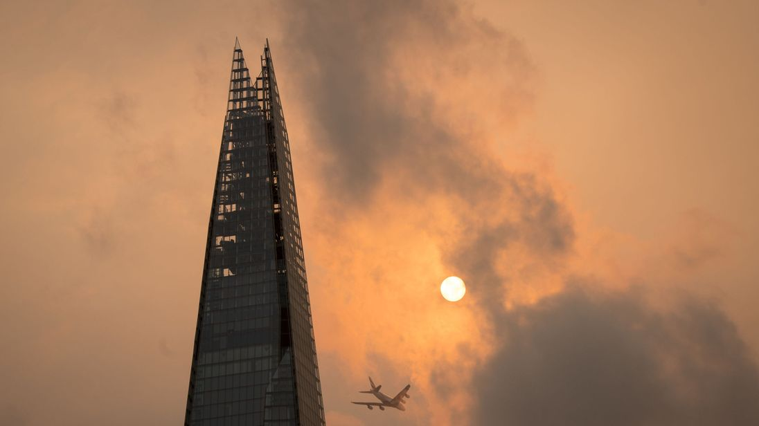 The Shard in central London, as the sky takes on an unusual orange colour caused by Storm Ophelia