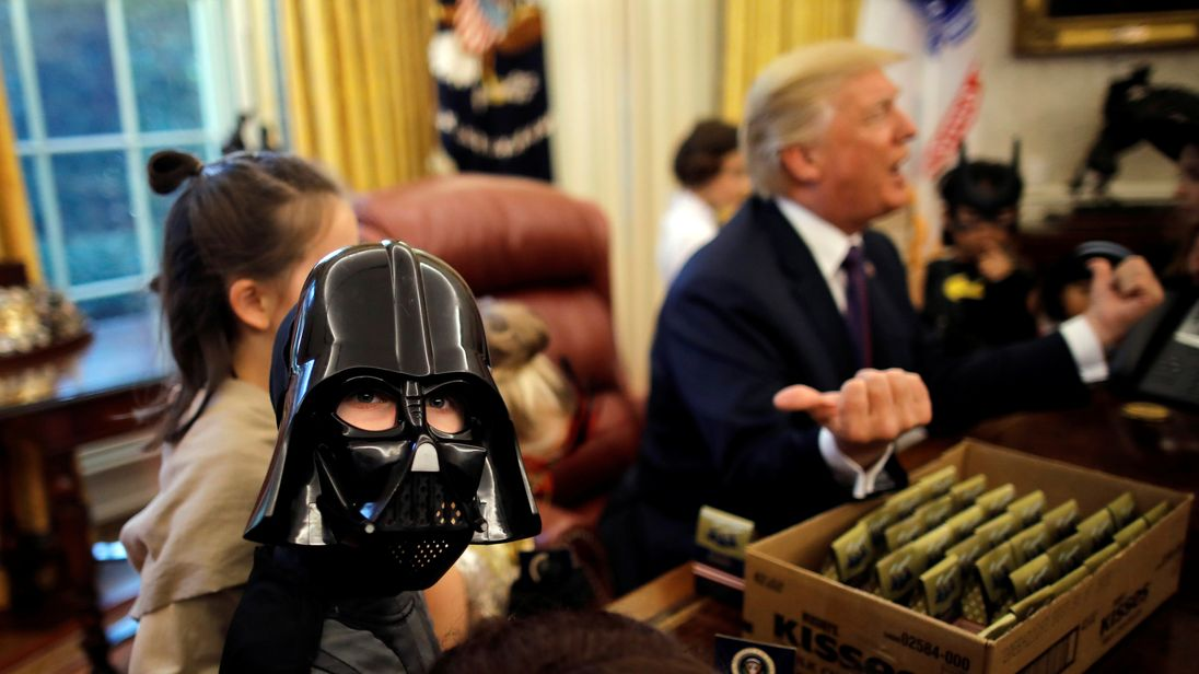 A boy dressed as Darth Vader meets President Trump