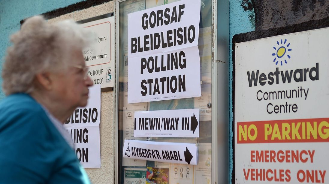 A woman arrives to cast her vote at the polling station in Westward Community Centre, Bridgend.