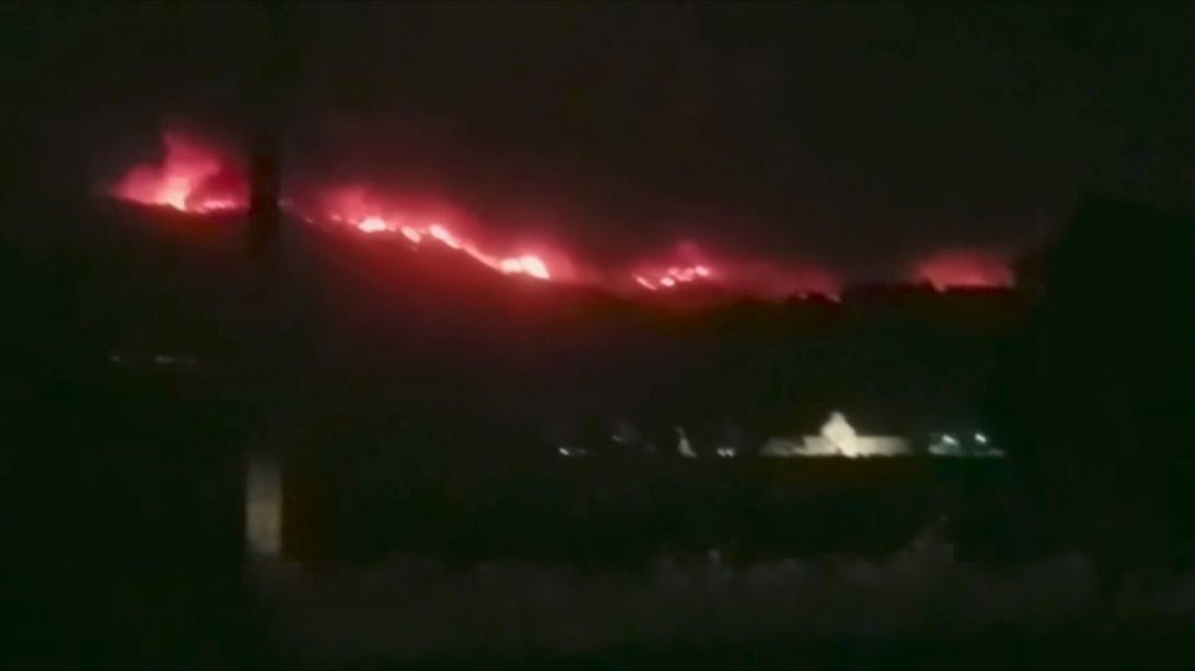 Hillsides alight above wineries in California's Napa Valley