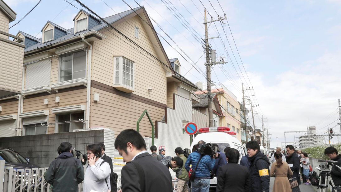 Members of the media gather in front of an apartment building where media reported nine bodies were found in Zama, Kanagawa Prefecture, Japan on October 31, 2017. Pic: Kyodo/REUTERS