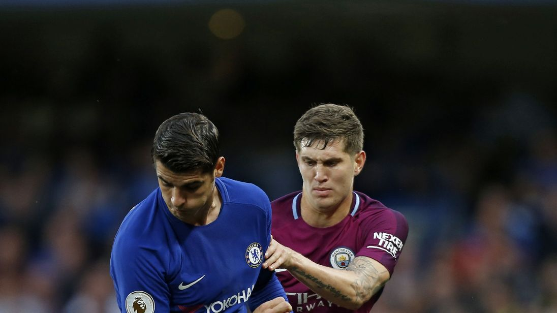 Chelsea's Spanish striker Alvaro Morata (L) vies with Manchester City's English defender John Stones during the English Premier League football match betwe