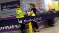 Airport staff speak by empty Monarch Airlines check-in desks after the airline ceased trading at Birmingham Airport, Britain October 2, 2017.