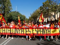Catalans carrying Spanish flags during a pro-union demonstration in Barcelona