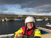 Burghead Coastguard with rescued cockapoo. Pic @MCA_media