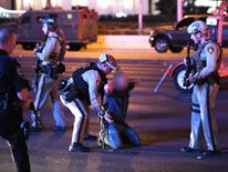 Police officers stop a man who drove down Tropicana Ave. near Las Vegas Boulevard and Tropicana Ave, which had been closed