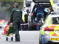 Paramedics help an injured woman