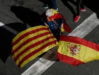 Many people brought Spanish and Catalan flags