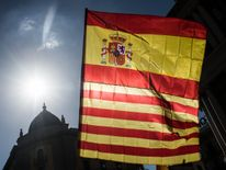 A Spanish and a Catalan flag at demonstration