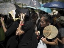People gathering to pay their respects to Thailand's late King Bhumibol Adulyadej