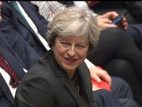 Theresa May sees the lighter side of an exchange in the House of Commons