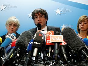 Sacked Catalan leader Carles Puigdemont gives a news conference at the Press Club Brussels Europe in Brussels
