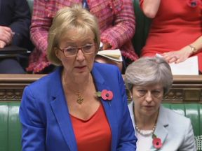 Theresa May sits behind Commons Leader Andrea Leadsom