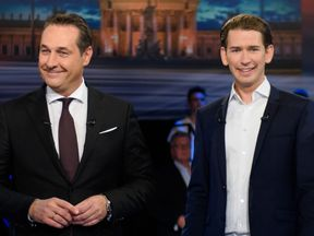 Heinz-Christian Strache (L) and Sebastian Kurz prepare for an election TV debate