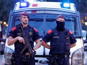 Police officers stand guard near the regional assembly in Barcelona