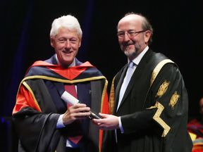 Former US president Bill Clinton receives an honorary doctorate from Dublin City University president Brian MacCraith