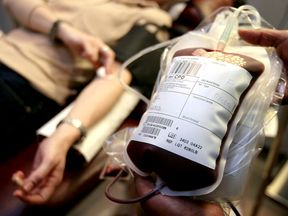 A donor gives blood at a National Blood Service centre in London, March 16, 2004. Britain is to ban people who have had transfusions over the past 24 years from donating blood to reduce the risk of spreading the human form of mad cow disease. [British Health Secretary John Reid announced the move three months after he reported what is throught to have been the world's first case of variant of Creutzfeldt--Jakob disease (vCJD) caused by transfusion.]