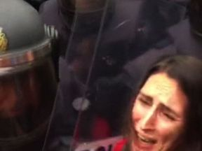 A woman cries as she's caught up in the street protests during the Catalan independence vote