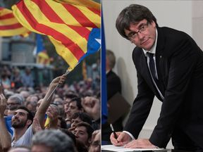 Carles Puigdemont signs a document declaring Catalonia's independence from Spain