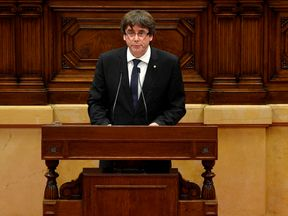 Catalan regional government president Carles Puigdemont gives a speech at the Catalan regional parliament