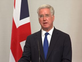 Michael Fallon warns that anyone fighting for IS is a legitimate target for RAF or US missiles in Iraq and Syria