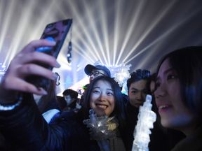 Chinese women pose for a selfie during New Year celebrations in Beijing on December 31, 2016