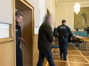 GERMANY-TRIAL-IRELAND-IRA The defendant (C) accused to have participated in an attack as a member of an IRA splinter group arrives to his trial in the regional court in Osnabrueck, northwestern Germany, on October 25, 2017. The former member of IRA was convicted on October 25, 2017 of attempted murder for his role in an attack on a British base in Osnabrueck in Germany 21 years ago. The court sentenced the Belfast-born man, identified in Irish papers as James Corry, to four years in jail. One ye