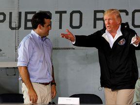 Donald Trump talks with Puerto Rico Governor Ricardo Rossello (left)