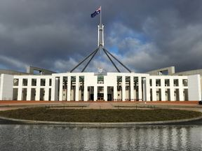 Clouds gather over Parliament House in Canberra