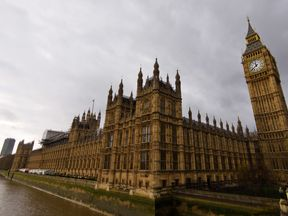 LONDON, ENGLAND - DECEMBER 02: A general view of The Houses of Parliament on December 2, 2015 in London, England. British MPs are expected to vote tonight on whether to back UK airstrikes on Islamic State targets in Syria following a 10-hour long debate. (Photo by Ben Pruchnie/Getty Images)