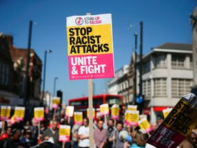 Demonstrators during a protest called by the 'Stand Up To Racism' group in Croydon, London, on April 8 2017 following a suspected hate crime attack on a Kurdish Iranian asylum-seeker