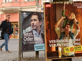 Posters in the capital advertise candidates for Austria's two governing parties