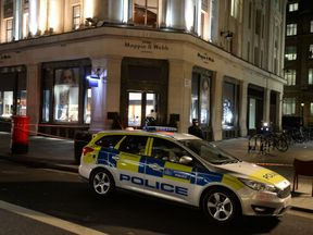 Police at the Mappin & Webb store in Regent's Street, central London following a smash and grab raid
