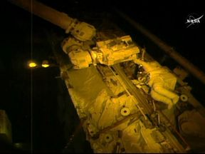Astronaut Joe Acaba works on a robotic arm on the ISS. Pic: NASA