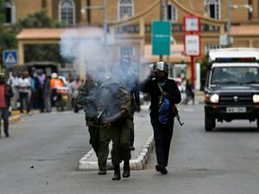 Riot police fire tear gas to disperse supporters of Kenya's opposition in Nairobi