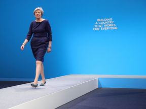 Prime Minister Theresa May arrives to make her keynote speech to delegates and party members on the last day of the Conservative Party Conference at Manchester Central on October 4, 2017 in Manchester, England