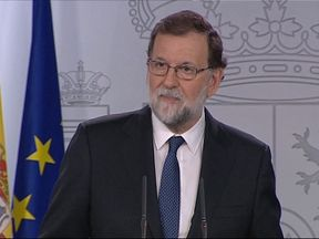 Spain's PM Mariano Rajoy says he has approved implementing Article 155 allowing the Madrid government to take back some powers from Catalonia
