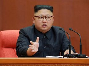 Kim Jong Un speaks to officials of the Workers' Party of Korea
