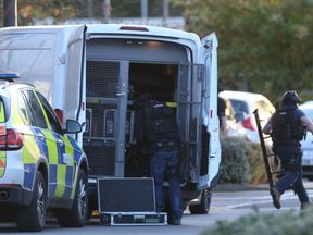 Police at the scene at Bermuda Park in Nuneaton where a gunman is holding two bowling alley members of staff hostage