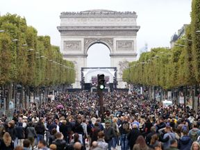 The Champs Elysees is a sea of bodies as it is free of cars