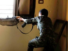 A fighter from the Syrian Democratic Forces battles IS militants in Raqqa