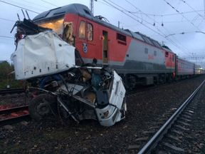 The wreckage of a passenger bus after it was hit by a train at a crossing near the town of Pokrov, in Vladimir region, Russia