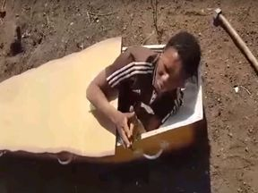 The video showed Victor Mlotshwa being shoved into a coffin