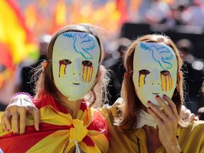 Women wear masks during a pro-union protest in Barcelona