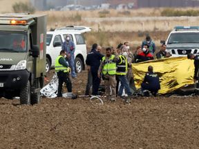 Rescue workers at the crash site of a military F18 fighter plane outside Madrid