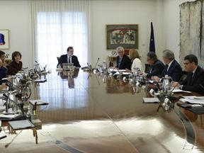 Spanish Prime Minister Mariano Rajoy presides a crisis cabinet meeting at the Moncloa Palace on October 21, 2017 in Madrid. Spain's government kicked off a crisis cabinet meeting as it prepares to seize powers from Catalonia's separatist government in a bid to stop the northeastern region's independence drive. / AFP PHOTO / POOL / Juan Carlos Hidalgo (Photo credit should read JUAN CARLOS HIDALGO/AFP/Getty Images)