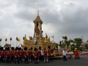 The Royal Urn is carried in the Royal Chariot through Bangkok