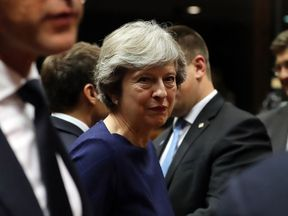 BRUSSELS, BELGIUM - OCTOBER 19:  Britain's Prime Minister Theresa May arrives for a round table meeting on October 19, 2017 in Brussels, Belgium. Under discussion are the Iran Nuclear Deal, Brexit and North Korea. Mrs May has offered assurances to EU nationals that her government will make it as easy as possible to remain living in the United Kingdom after Brexit.  (Photo by Dan Kitwood/Getty Images)