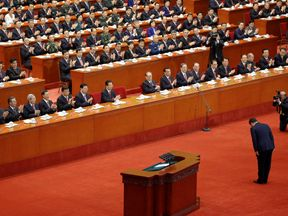 Chinese President Xi Jinping bows before delivering his speech