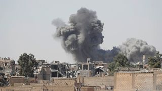 Smoke rises at the positions of the Islamic State militants after an air strike
